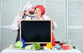 Share Joy. Man And Woman Chef Cooking Food Together. Couple With Blackboard For Advertisement. Lovel poster
