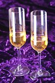 Two wineglasses with champagne on velvet