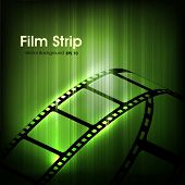 Film stripe or film reel on shiny green movie background. EPS 10