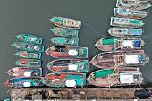 Fishing boats in port in Thailand. Overfishing environmental problem. Khura Buri, Andaman Sea, Thail poster