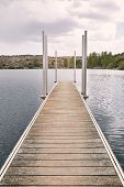 Empty Dock On A Quiet Lake. Travel Concept. Holiday Concept poster