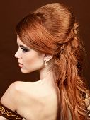 Beautiful Woman With Red Hairstyle Luxuriant Long Hair.