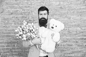 Surprise Will Melt Her Heart. Romantic Man With Flowers And Teddy Bear. Romantic Gift. Macho Getting poster