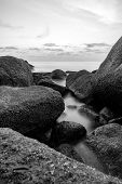 Seascape Of Rocks In The Foreground Long Exposure Composition Of Nature For Background poster
