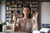 Calm Young Woman Meditate With Eyes Closed At Workplace poster