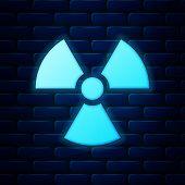 Glowing Neon Radioactive Icon Isolated On Brick Wall Background. Radioactive Toxic Symbol. Radiation poster