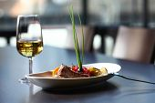 A Good Meal With Wine. Close Up Of A Dish With Meal, Rice And Mushrooms And A Glass Of Wine In Backg poster