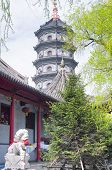 A Pagoda At Jile Temple (temple Of Bliss) In Harbin China In Heilongjiang Province. English Translat poster