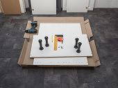 Ready-to-assemble Furniture. Open Box With Furniture. Top View. poster