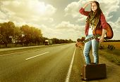 Yong Girl  With Guitare And Old Suitcase At The Highway