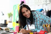 Portrait Of Widely Smiling Professional Designer Working On New Project. Young Woman Making Sketch O poster