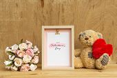 Mockup Picture Frame And Cute Bear Holding Red Heart With Bouquet Of Pink Roses On Rusty Wood. Valen poster