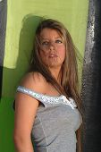 In front of a greenish paint on the wall 1