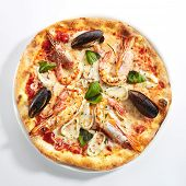 Italian seafood pizza with squid rings, mussels and shrimps on white restaurant plate isolated. Pizz poster