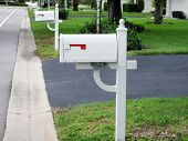 image of mailbox  - an image of white mailboxes in a row - JPG