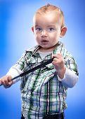 Cute little boy swings golf club