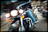 Abstract slow motion, bikers riding motorbikes, drivers racing on a bikes, front view, blur movement