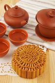 Mooncake and tea set on table. Mooncake traditionally eaten during the Mid-Autumn Festival. Chinese