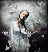 Imagination. Romantic Blonde With Hovering Origami Birds In Spooky Forest. Magic