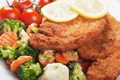Viener schnitzel, breaded steak with grated vegetables