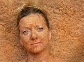 picture of mud pack  - woman with facial mud blends into background - JPG