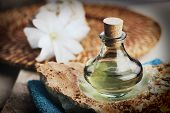 stock photo of oil well  - Spa and wellness setting with floral water towel and flower - JPG
