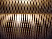 stock photo of dimples  - A close up shot of the patterned dimples in a speaker.