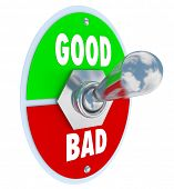 The words Good and Evil on a toggle switch lever to decide or judge whether something is beneficial