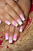 stock photo of french manicure  - The French manicure nails and chamomile flowers - JPG
