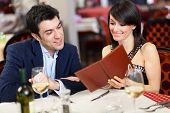 Couple reading the menu in a restaurant