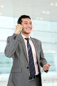 picture of handphone  - busy young business man hold the handphone - JPG