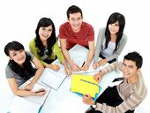 stock photo of classmates  - Group of students studying together seen from above - JPG