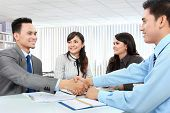 Business Team Making A Deal