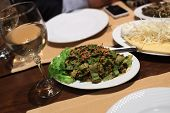 stock photo of tabouleh  - Plate of Tabouleh salad on a table in an armenian restaurant - JPG