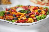 stock photo of buffet catering  - Platter of colourful cooked cold vegetables on a buffet table at a catered event - JPG
