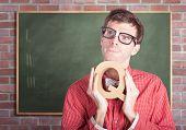 Smart Male School Teacher With Education Question