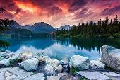Mountain lake in National Park High Tatra. Dramatic overcrast sky. Strbske pleso, Slovakia, Europe. Beauty world.