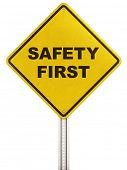 "3d rendering of a yellow traffic sign with ""safety first"" written on it."