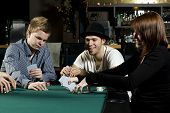 People Playing Poker Around Table