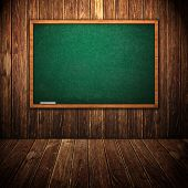 stock photo of first class  - Green school chalkboard in wooden interior - JPG