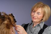 Attractive Mature Lady Hair-stylist Blow Dries Hair