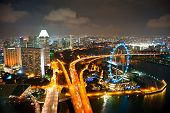 foto of singapore night  - Aerial view of Singapore with Singapore Flyer in the right corner - JPG