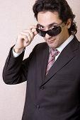 The Businessman In Sunglasses