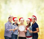 education, christmas, happiness and people concept - group of smiling students in santa helper hats