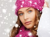 winter, people and happiness concept - woman in pink hat and scarf