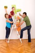 Happy Family With Painting Utensils Repainting Their Home
