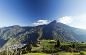 stock photo of andes  - The town of Banos beneath Tungurahua volcano in the Ecuadorian Andes - JPG