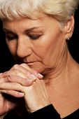 image of life after death  - Portrait of old woman praying - JPG