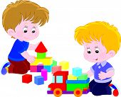 image of kiddie  - Little boys playing with a toy truck and bricks - JPG