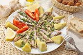 portuguese traditional recipe - scaled and boiled horse-mackerel with potatoes and olive oil